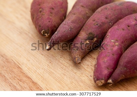 Yam on a wood background - stock photo