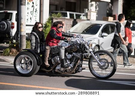 YAMANASHI, JAPAN - NOVEMBER 03, 2014: Unidentified japanese biker on a three-wheeled motorcycle. - stock photo