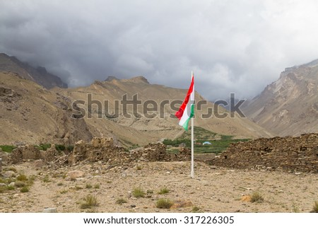 Yamchun Fort is the most visually prominent historic site in the Wakhan Valley in Gorno-Badakhshan Autonomous Province, Tajikistan. The mountains in the distance are in Afghanistan and Hindukush.  - stock photo