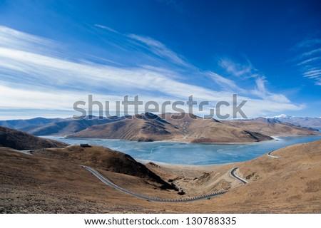 YamdrokTso under blue sky - stock photo