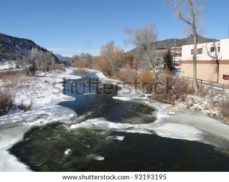 Yampa River with ice and cottonwoods in winter, Steamboat Springs, Colorado - stock photo