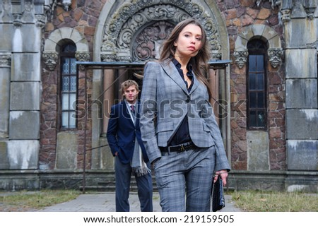 Yang fashion couple pose outdoor in front of old building. - stock photo