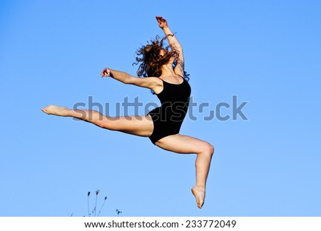 Yang female dancer performing outdoors. - stock photo