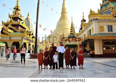 YANGON - FEB 12: Temple goers visit Shwedagon Pagoda on Feb 12, 2013 in Yangon, Burma. Built between 6th and 10th century the landmark Shwedagon is considered Burma's most sacred Buddhist temple. - stock photo