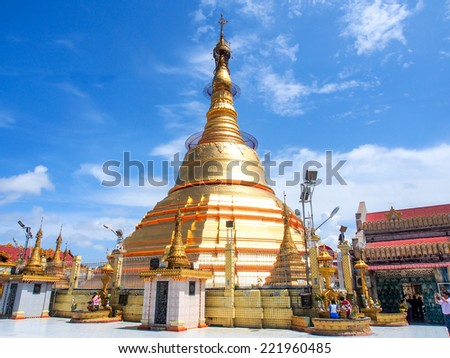 YANGON MAY 24: the golden Botataung pagoda located in downtown Yangon, Myanmar on May 24, 2014. This pagoda was completely destroyed during World War II, and was rebuilt after the war. - stock photo