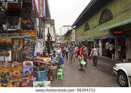 YANGON, MYANMAR - FEB 27: Famous shops at Bogyoke Market on February 21, 2012 in Yangon, Myanmar. Bogyoke Market was built in 1926 and was formerly known as Scott Market. - stock photo