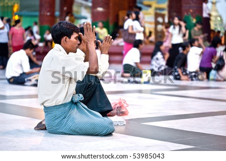 YANGON, MYANMAR - JAN 31: Buddhist devotees praying at the full moon festival, Shwedagon Pagoda, January 31, 2010 in Myanmar (Burma).