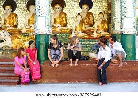 YANGON, MYANMAR - JAN 15: Unidentified talk to enjoy of burmese and foreign tourist at Shwedagon Pagoda on January 15, 2016 in Yangon, Myanmar. It is 1 in 5 The most important place of worship  - stock photo