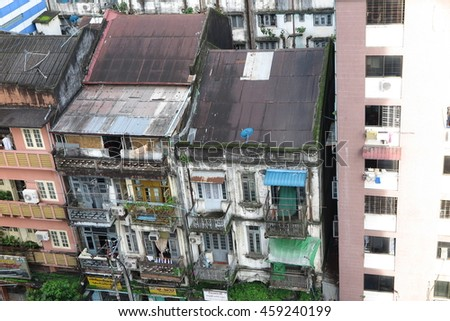 YANGON, MYANMAR - JULY 23, 2016 : Yangon city view from Chinatown, there is many British old Building in China town and traditional fresh market  in Yangon, Myanmar