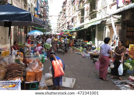 YANGON, MYANMAR - JULY 25, 2016 : Yangon market, fresh market in Chinatown, lots of food, raw food, vegetable, meat, fruit in Yangon, Myanmar