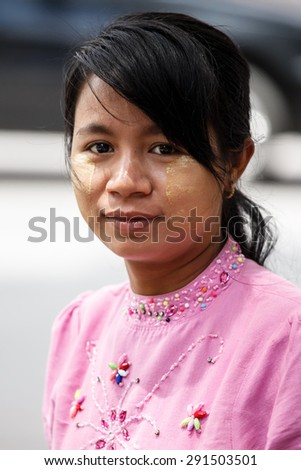YANGON, MYANMAR - JUNE 12 2015: Lady street vendor on one of the hottest recorded days before monsoon season in Yangon, Myanmar. - stock photo