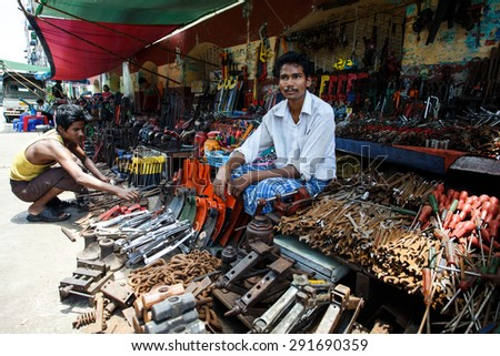 YANGON, MYANMAR - JUNE 12 2015: Metal tool shop on one of the hottest recorded days before monsoon season in Yangon, Myanmar. - stock photo