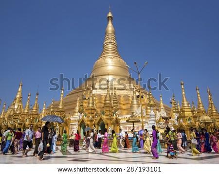 Yangon, Myanmar - March 8: Pilgrims and tourists at sacred Shwedagon Pagoda in Yangon, Myanmar (Burma).  - stock photo