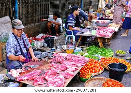Yangon,Myanmar- March 24, 2013:Trading activities at the morning market. This is a local market in downtown Yangon where people come from all over the area to sell fruits,vegetables, meal, etc.