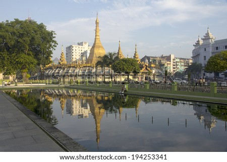 Yangon, Myanmar-May 8th 2014: Sule Pagoda reflected a pond. The pagoda is considered to be the centre of Yangon and the point from which distances to other places are measured.