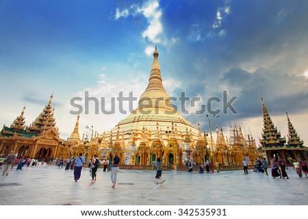 Yangon, Myanmar. Nov 18, 2015. Myanmer famous sacred place and tourist attraction landmark - Shwedagon Paya pagoda illuminated in the evening. - stock photo