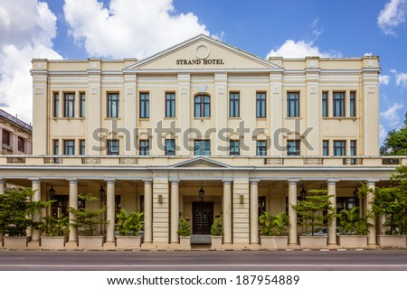 YANGON, MYANMAR - NOVEMBER 3, 2013 - The Strand Hotel facade on November 3, 2013 in Yangon. The Strand is a luxury hotel built during British colonial times, located on Strand Road in Yangon. - stock photo