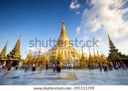 YANGON, MYANMAR-November 22 : Unidentified people walking around in Shwedagon pagoda on November, 2015, Yangon, Myanmar.Shwedagon Pagoda is the most sacred Buddhist pagoda for the Burmese. - stock photo
