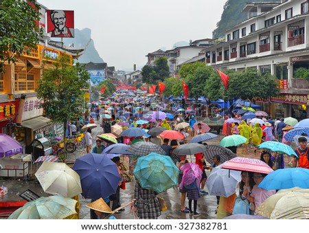 YANGSHUO - OCTOBER 4: people visit West street during National Day holiday on October 4, 2015 in Yangshuo, China. In year 2014 Yangshuo was visited by almost 40 million people from China and abroad.