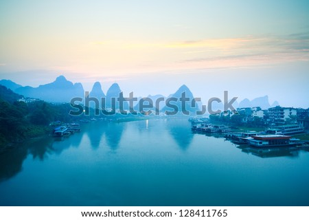 yangshuo scenery in dawn,tranquil landscape in guilin,China. - stock photo