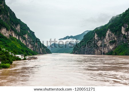 YANGTZE - AUGUST 21: Travel by boat on the Yangtze River with a view of the mountains, on August 21.2012, Yangtze, China
