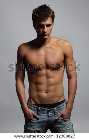 yaoung man posing on a grey background - stock photo