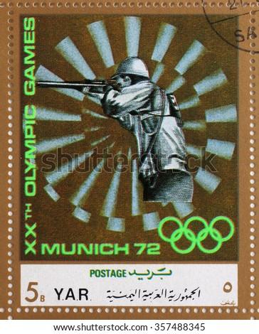 YAR - CIRCA 1972: A stamp printed in Yemen Arab Republic shows sport Shooting, Olympics in Munich, circa 1972 - stock photo