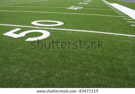 Yard Lines of a Football Field at the Fifty - stock photo