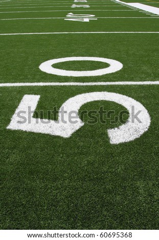 Yard Lines of a Football Field starting at the Fifty - stock photo