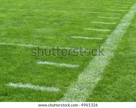 yard markers on an American football field - stock photo
