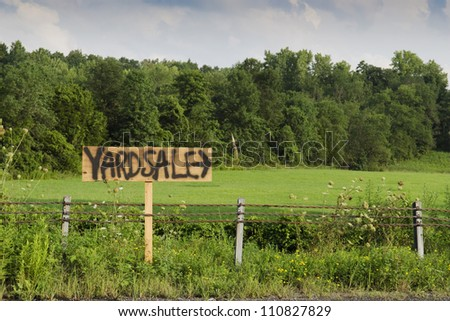 yard sale sign on country road - stock photo
