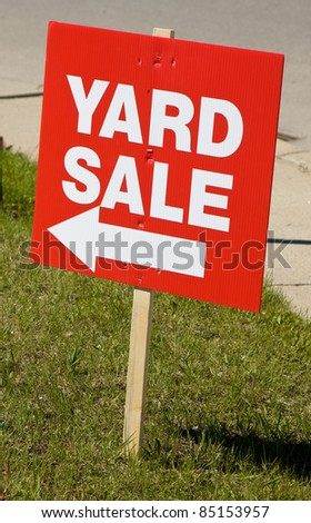 Yard sale sign on lawn - stock photo