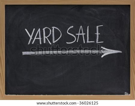 yard sale text handwritten with white chalk on blackboard - stock photo