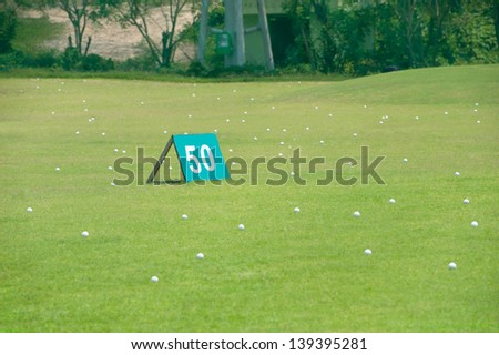 yard signs in golf driving range - stock photo