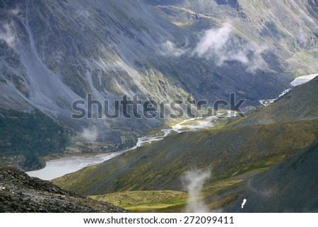 Yarlu valley - aerial view to river between mountain slopes - stock photo