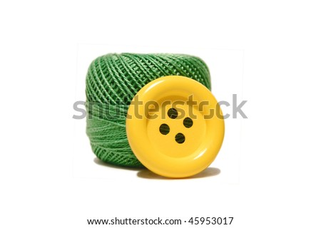 yarn ball and button isolated on white background - stock photo