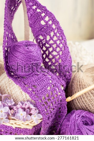 Yarn for crochet and knitted openwork napkins, still life photo with tools for handmade.