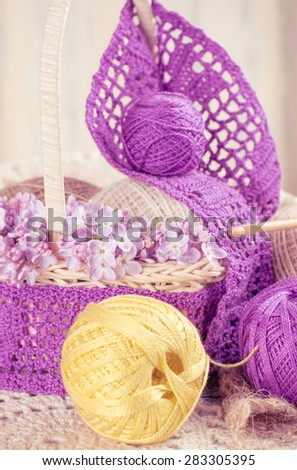 Yarn for crochet and knitted openwork napkins with lilac  - stock photo