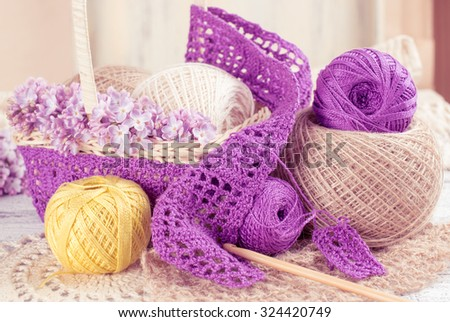 Yarn for crochet and knitted openwork napkins with lilac on shabby wooden boards