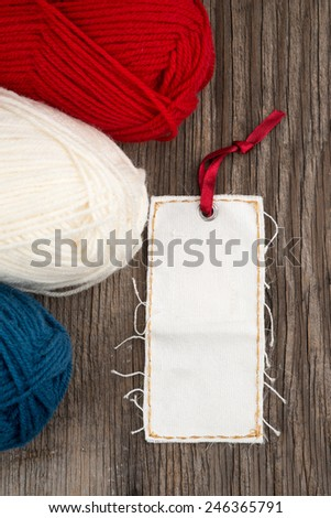 Yarn for knitting and blank price tag or label - stock photo