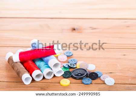 Yarn scissors ,measuring tape and Yarn Sewing with wood background - stock photo