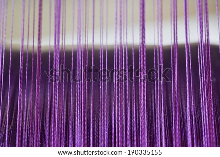 yarn thread running in the machine - stock photo