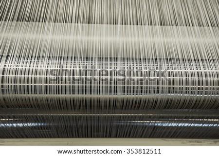 Yarn warping machine in a textile weaving factory. - stock photo