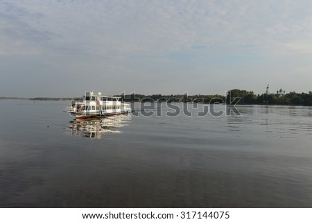 YAROSLAVL, RUSSIA - AUGUST 21, 2013: Yaroslavl is one of the oldest Russian cities, founded in the XI century on the Volga river.Ship sailing along the Volga.