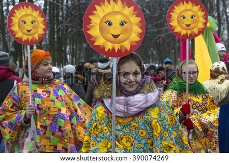YAROSLAVL, RUSSIA - MAR 06, 2016: Participants of festive procession on old Russian town Yaroslavl's streets during celebration Maslenitsa - stock photo