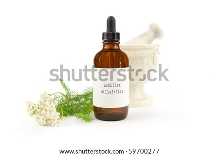 Yarrow herbal tincture, Achillea millefolium. The label was made for the photo shoot. Achillea millefolium is the Latin name of yarrow, not a brand name or a trademark. - stock photo