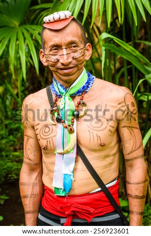 YASUNI, ECUADOR - JAN 4, 2015:  Unidentified Ecuadorian indian portrait. Indigenous indians  are protected by COICA (Coordinator of Indigenous Organizations of the Amazon River Basin) - stock photo