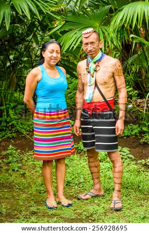 YASUNI, ECUADOR - JAN 4, 2015:  Unidentified Ecuadorian indian with a girl. Indigenous indians  are protected by COICA (Coordinator of Indigenous Organizations of the Amazon River Basin) - stock photo