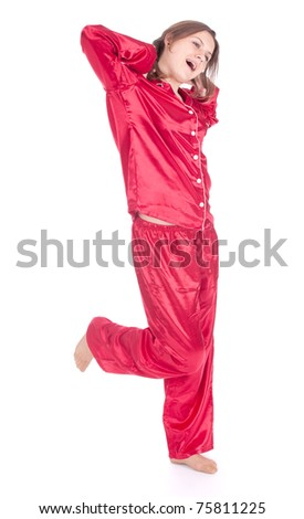 yawning and stretching young woman in red pajamas, full length, series - stock photo