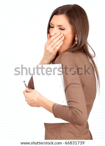 yawning beautiful young woman in brown blouse with blank card - stock photo